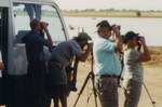 Watching Egyptian Plover with Mauritania and the Sahara in view across the Senegal River