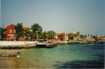 Lagoon and portuguese colonial houses at notorious Goree Island