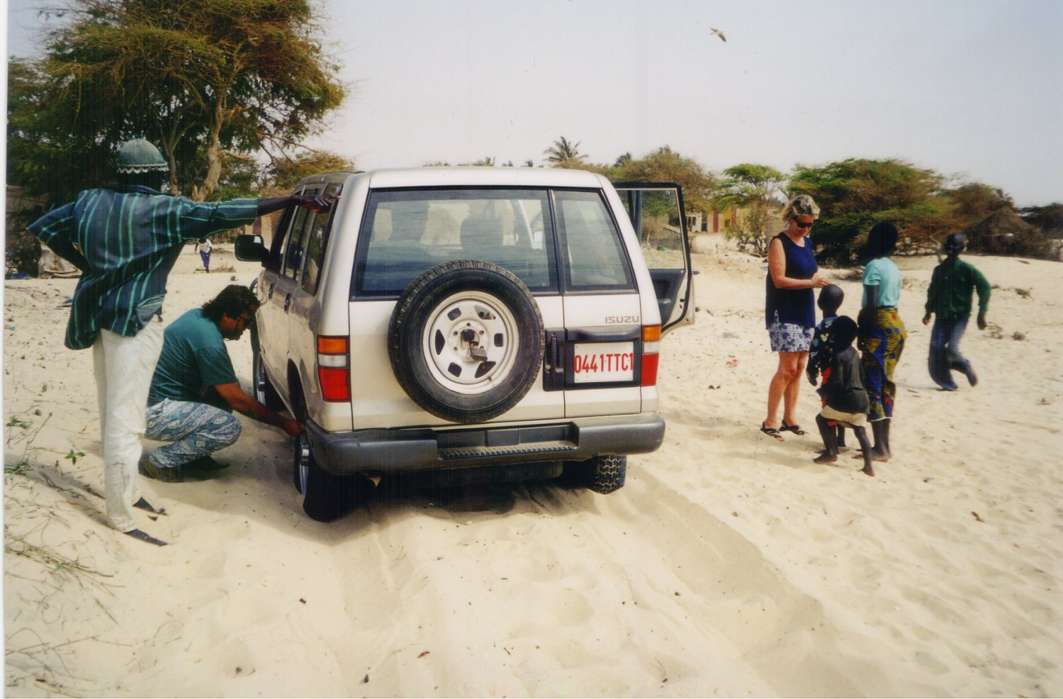 Pierre Reynaud of IRD letting air out of tires for better traction in the sand on Mboro Beach